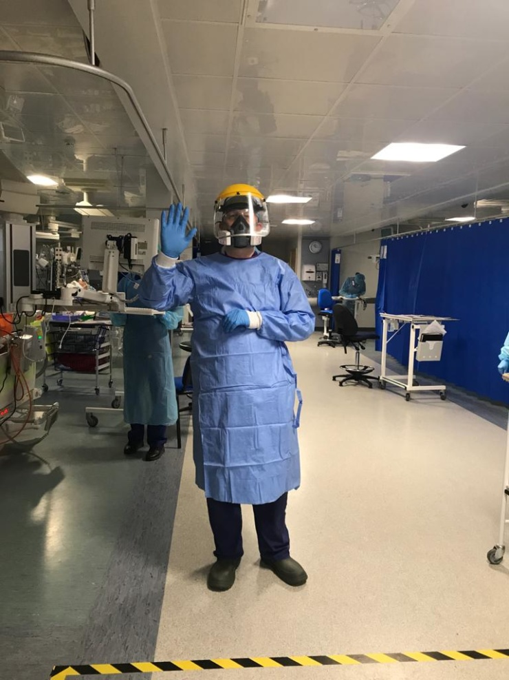 A photo of Dr Tim Felton on the front line wearing PPE