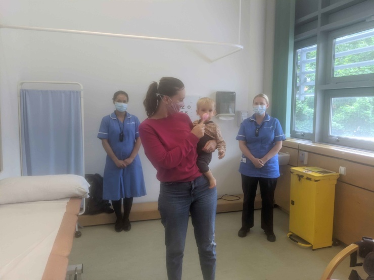 A photo of Senior paediatric clinical research nurses, Tahira Dawoodji and Kate Wilkins, with Hazel and Elsie Palmer