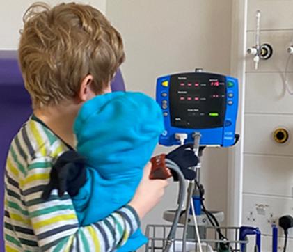 Leo being shown the blood pressure machine