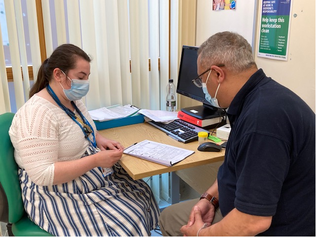 Natasha carrying out a PHOSP-COVID study assessment with a participant