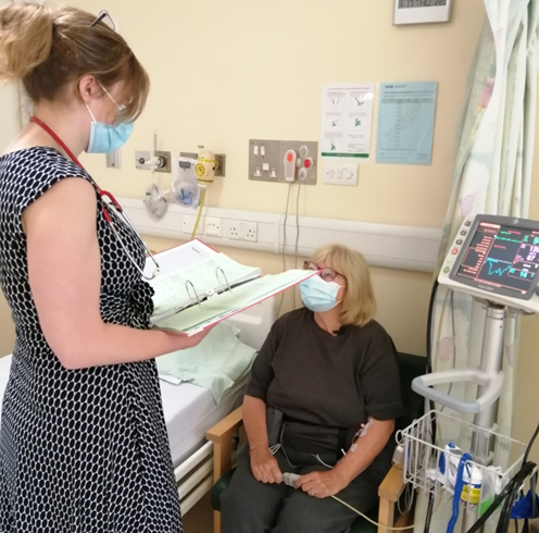 Dr Jenny King, Clinical Research Fellow, sub investigator on the study, checking on Joan after she's received a dose of the study drug.
