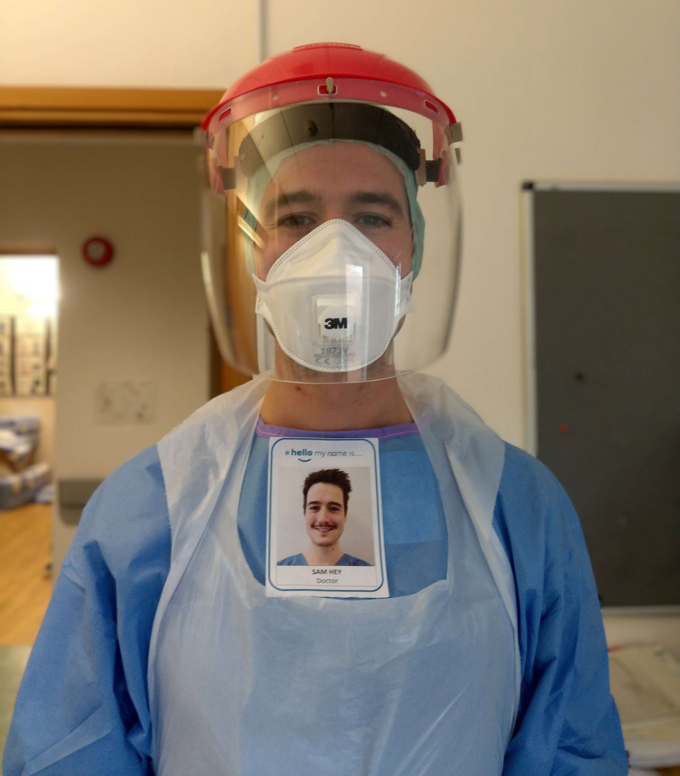 Image shows Dr Samuel Hey in Personal Protective Equipment (PPE) during COVID-19